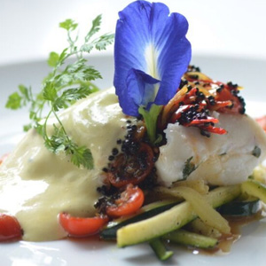 Slowly Cooked Cod Fish, Spicy Tomatoes Saffron Butter Espuma